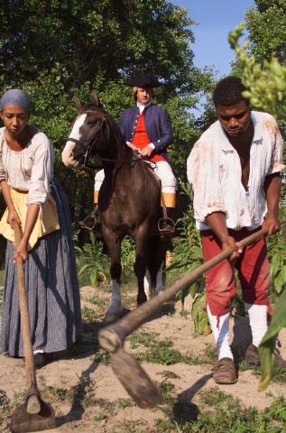 Colonial Williamsburg actor-interpreters performing a scene