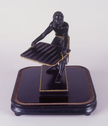 Cigar display in the form of a slave statuette