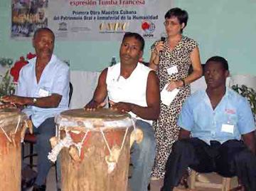 Tumba Francesa musicians playing the <i>tambores</i> and <i>catá</i>
