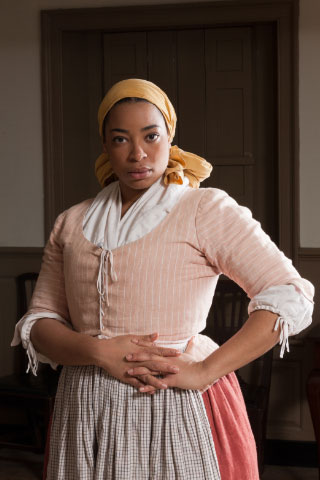 An actor-interpreter portrays Lydia Broadnax